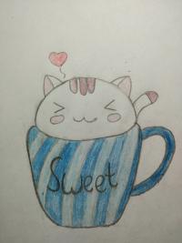 милашного котенка в чашечке детям