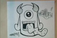 Рисунок граффити: одноглазого монстра на бумаге