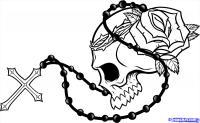 Фотография череп с розой четками и крестом на бумаге